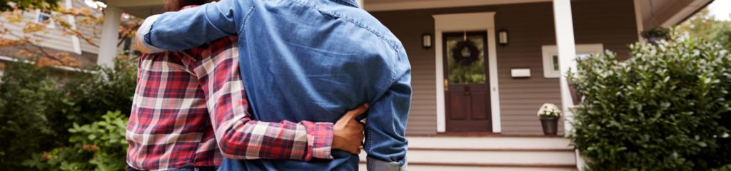 Couple standing outside of home in fresh air